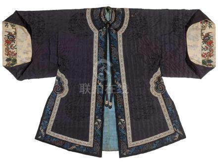 A PADDED WINTER SURCOAT WITH PEKINESE STITCH EMBROIDERY, QINGTextured silk with multi-colored silk