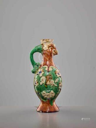 A RARE SANCAI-GLAZED 'PHOENIX' EWER, TANG DYNASTYThe finely potted body of elegant ovoid form,