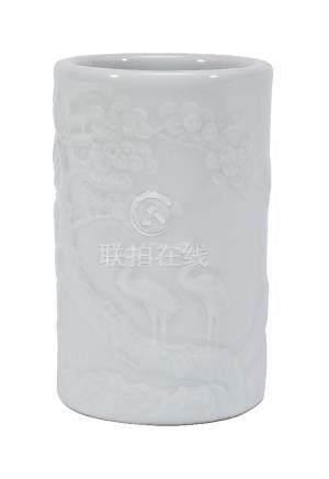 A Chinese white glazed brush pot