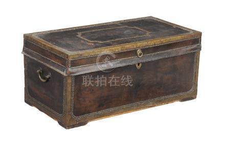 A Chinese leather and brass mounted camphorwood trunk
