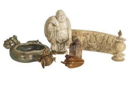 ϒ A Japanese ivory Okimono of Hotei