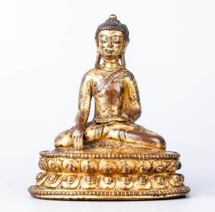 A Chinese Tibetan Gilt Copper Figure Of Buddha