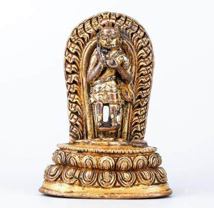 A Nepalese Gilt Bronze Standing Figure Of Buddha