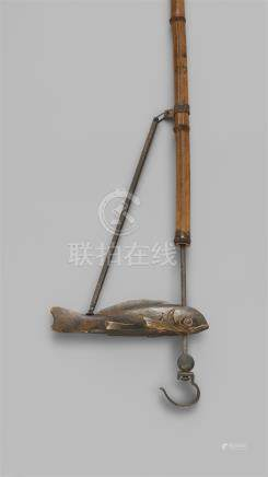 An iron, bamboo and wood adjustable pont hanger (jizai). Late 19th/20th century