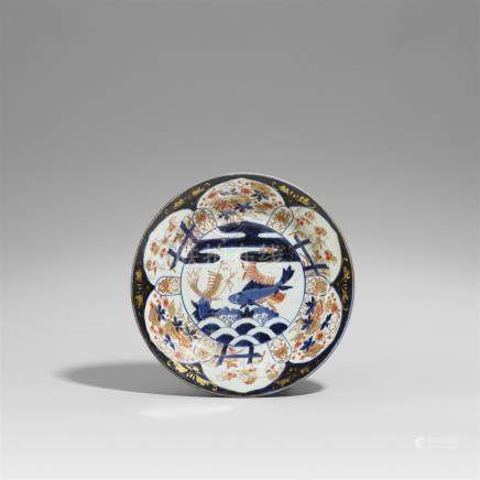 An Arita Imari plate. Early 18th century