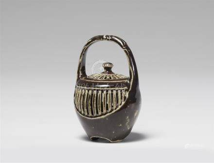 A small lidded jar. 19th/20th century
