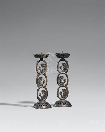 Two nanban bronze candle sticks. 19th century