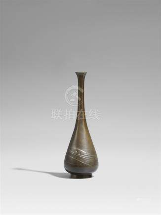 A slender bronze vase. Around 1900