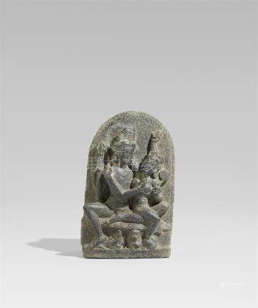 A Pala dark gray stone stele of Uma Maheshvara. Northeastern India. 9th/10th century