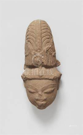 A Central Indian sandstone head of a male deity. 12th/13th century