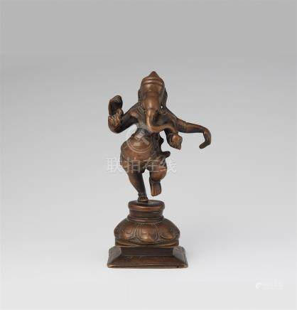 A South Indian copper alloy figure of a dancing four-armed Ganesha. 19th/20th century
