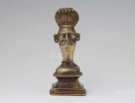 A Maharashtra brass Shiva linga. 19th/20th century