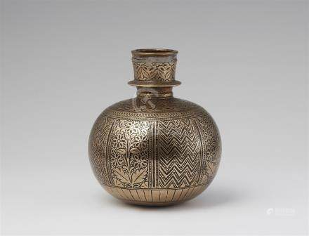 A North Indian carved brass huqqa base.  Lucknow. 17th/18th century