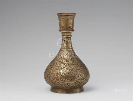 A vase-shaped carved brass huqqua base. Lahore. 17th century
