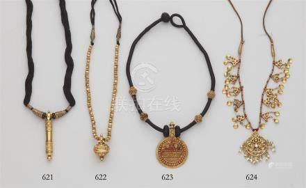 A necklace with a tubular pendant. Tamil Nadu
