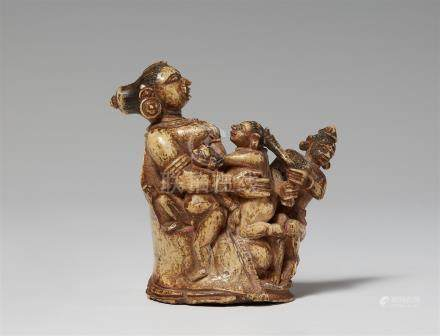 An Orissa bone carving of a mother with children. Northeastern India. 19th/20th century