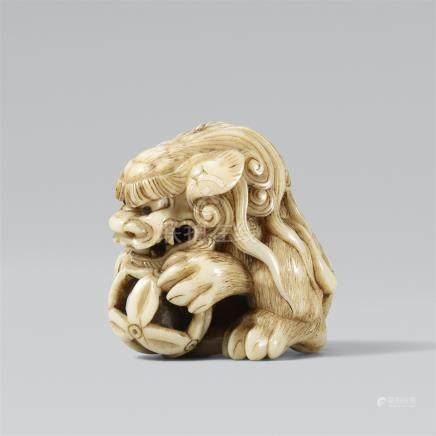 Shishi with a sphere. Ivory