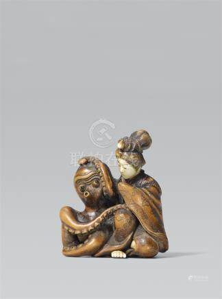A lady and an octopus. Boxwood and ivory An octopus next to a young girl in a rich kimono trying to get erotically closer to her with one of his long arms, which apparently doesn't make her uncomfortable. Boxwood, head, hand and feet of the girl of marit