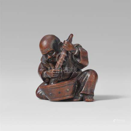 Farmer stirring mochi dough. Boxwood and bone. Second half 19th century