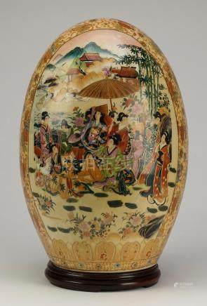 Chinese porcelain egg, decorated with court officials