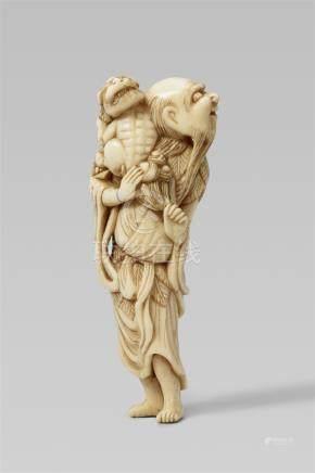 An ivory netsuke of a sennin with a shishi. 18th century
