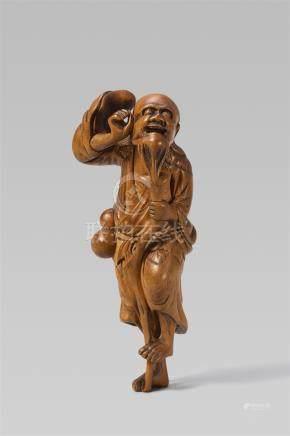 A boxwood netsuke of a bearded Tekkai Sennin. Late 18th/early 19th century