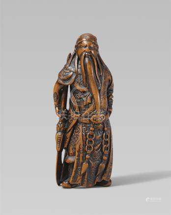 An excellent Edo school boxwood netsuke of a portly Kan'u, by Minkoku. First half 19th century