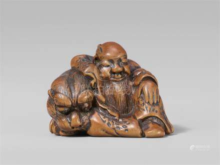 A charming boxwood netsuke possibly of Bunkan Zenshi. Early 19th century