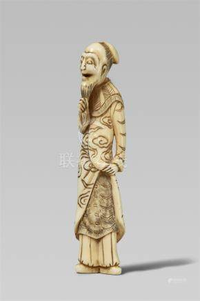 An ivory netsuke of a comical Chinese man. Early 19th century