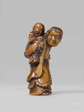 A boxwood netsuke of a Dutchman with a child. Early 19th century