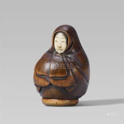 A boxwood netsuke of an Onna-Daruma doll. Late 19th century