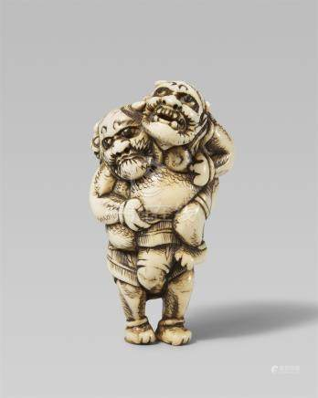 A good and amusing ivory netsuke of two wrestling onis. Early 19th century