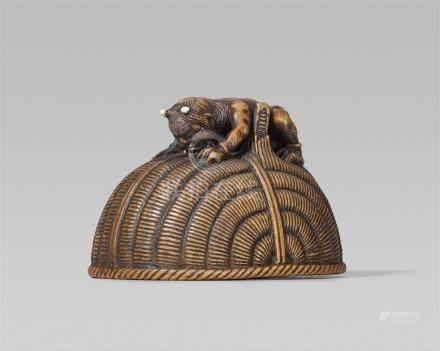 An amusing wood netsuke of an oni and Shôki, by Chikusai. Second half 19th century
