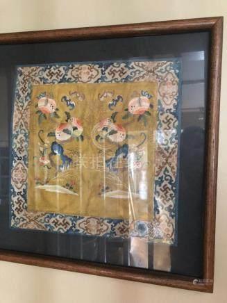 framed silk hanging with peach décor