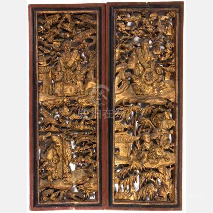 A Pair of Chinese Heavily Carved and Gilt Lacquered Panels,