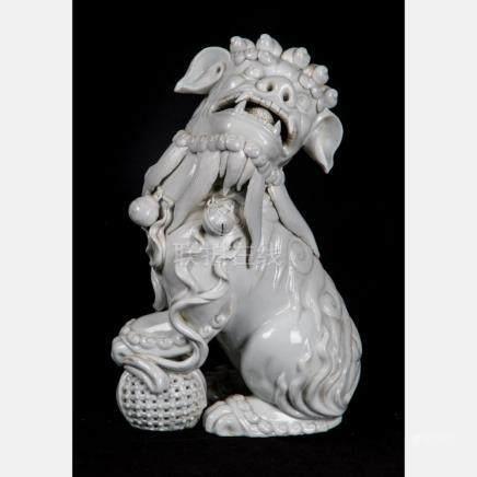A Chinese Porcelain Blanc de Chine Foo Dog, 20th Century.