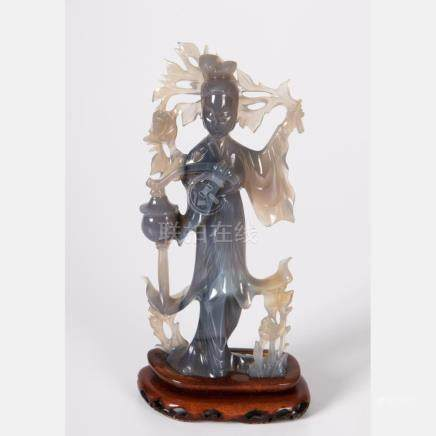 A Chinese Carved Blue Agate Figure of Guanyin,