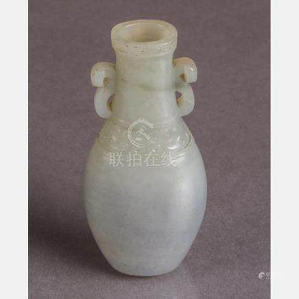 A Chinese Small Pale Greyish-Green Jade Archaistic Vase, Qin