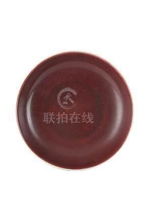 A RED-GLAZED DISHChina, Qing dynasty, Qianlong