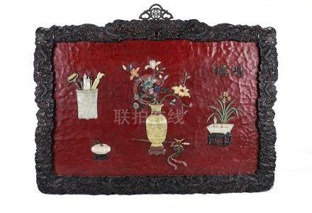 Chinese lacquer wall hanging panel with carved soapstone decorations.