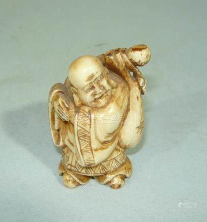Netsuke. Wandere w, stick a. bag. Ivory, hand cut.