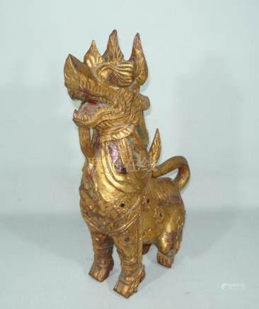 Large tempel lion. Wood, colored a. w. gem stones. Prob. Bal