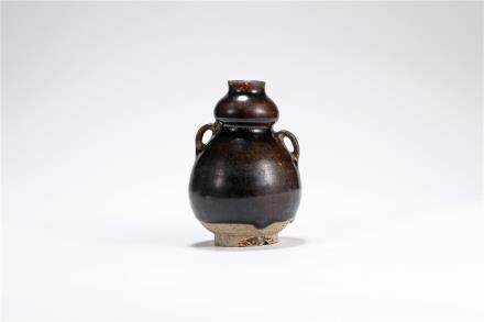 A Gongxian Kiln Black-Glazed Gourd Bottle Of Five Dynasty