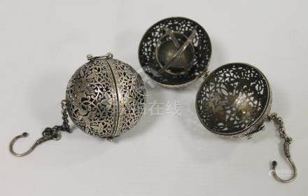 Pair of Chinese white metal spherical incense vessels, the interiors with gimbles. 5cm diam.
