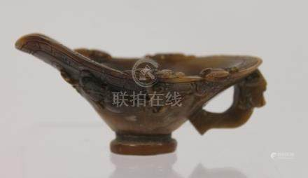 Chinese carved horn libation cup. 9.5cm wide.