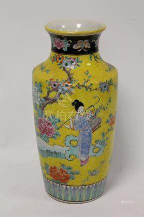 Oriental porcelain vase decorated with Chinese figures in a garden in polychrome enamels on yellow