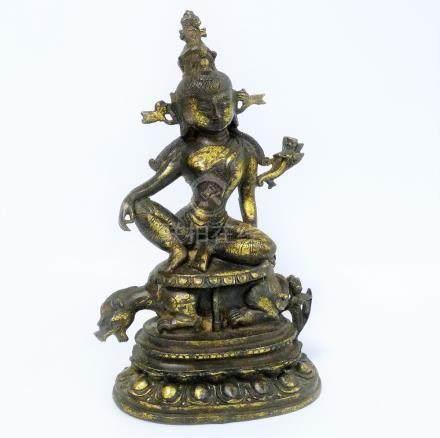 Large Sino-Tibetan cast metal figure of a deity astride a leopard,