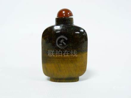 Chinese tiger's eye snuff bottle of round rectangular form. 6cm.