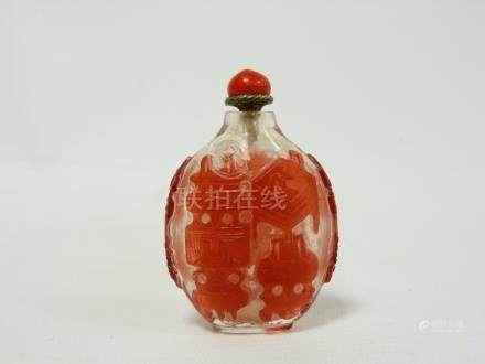 Chinese carved red overlay clear glass snuff bottle decorated with censers. 7cm high.