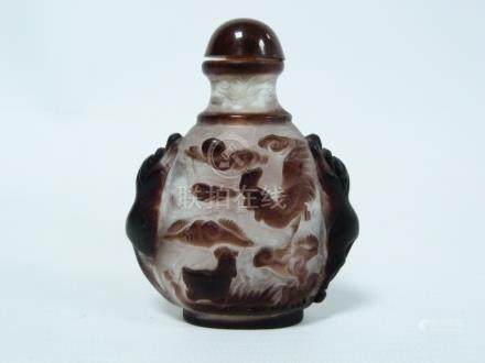 Chinese carved purple overlay clear glass snuff bottle with fox handles,